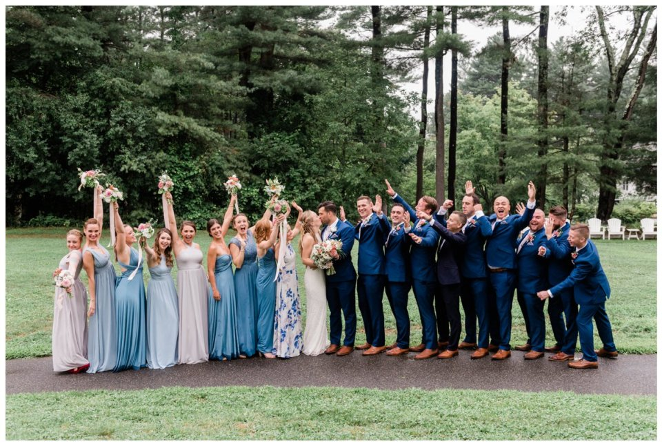 Warren Conference wedding party formal photo bride and groom kissing bridesmaids and groomsmen cheering