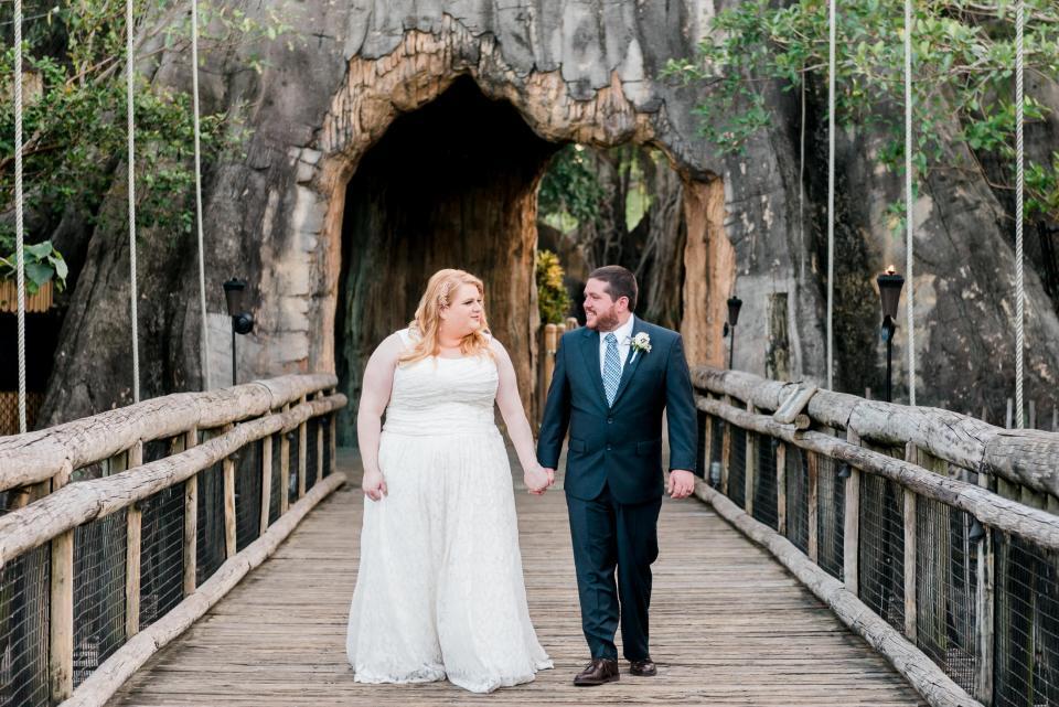 A wedding couple takes portraits at their palm beach zoo wedding.