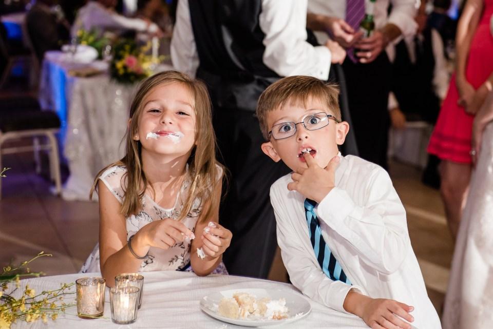 Kids eating wedding cake at a lake pavilion wedding in west palm beach florida