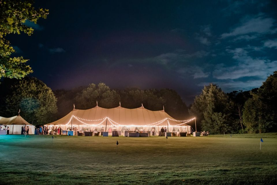 Sperry tent wedding at night