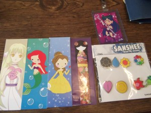More bookmarks, a Sailor Pluto badge, and yes, those are REAL MEDAL POKEMON SEASON ONE GYM BADGES!!! I'm the coolest person on the block now! ^_-