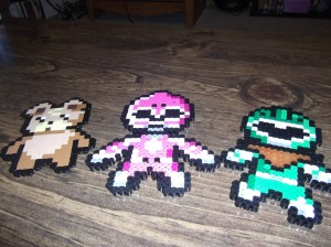 My bead creations. The pink is a custom for me and the green ranger for Miles.