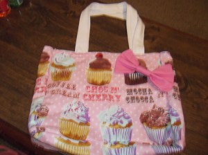 My super kawaii cupcake bag I am going to use once school starts! Thanks Derrick for getting it for me.  He also got me a Black Butler poster! :)