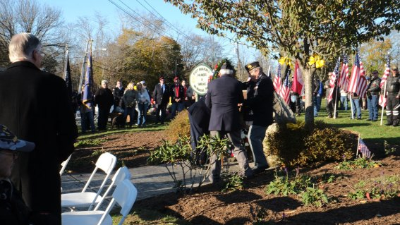 laying wreath - 2018 East Moriches Veterans Day Parade