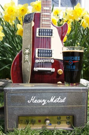A guitar, an American porter and daffodils in the back ground
