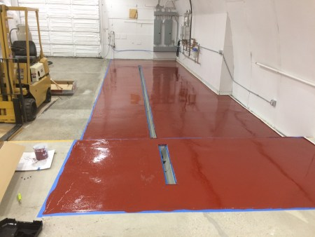 First coat of new red epoxy floor in the brew area