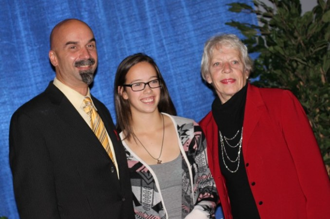 Vivian Pezer and Todd Eistetter pose with MCHS Howls Award recipient Angeline Charrois.