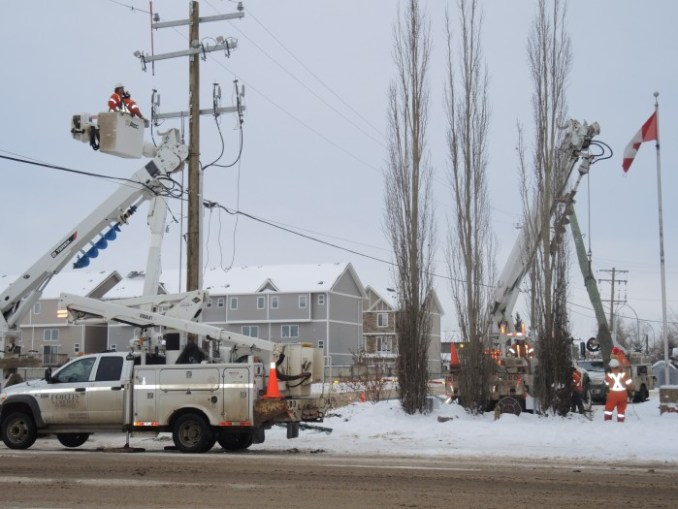 Fortis Alberta workers installed a new pole on 101 Avenue near the fire hall Dec. 9.