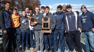 Photo of Susan E. Wagner H.S.'s Cross Country team as they hold their 2018–19 PSAL championship trophy.