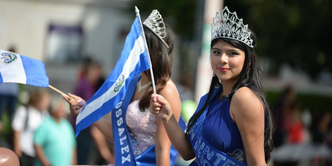 Beauty Queen holding Argentinian flag during Hispanic Heritage Parade