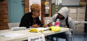 Volunteer registering student to vote