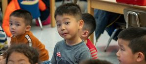 Kindergartener looking curiously at photographer