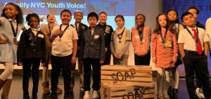 Elementary School students on a stage for Project Soapbox