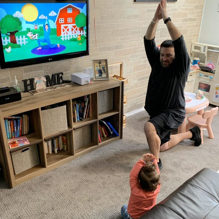 Dominic Armano doing some indoor yoga with his child