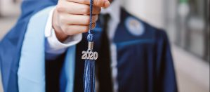 "Close-up of a blue tassle that reads, ""2020."""