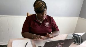P.S. 277 principal, Natasha Bracey-Ferguson sitting at her desk with laptop