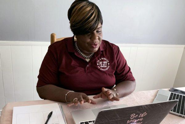 P.S. 277 principal, Natasha Bracey-Ferguson sitting at her desk with laptop