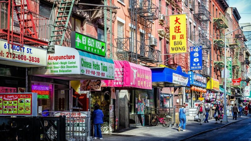 A row of storefronts on Mott Street in Chinatown NYC
