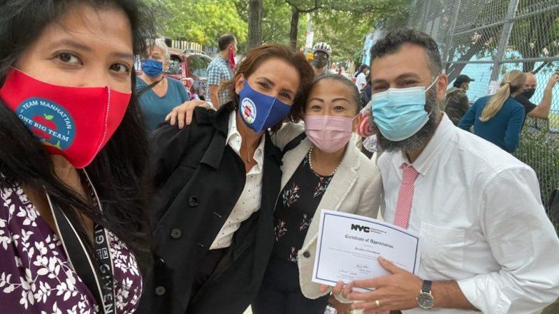 Senior Deputy Chancellor Marisol Rosales (center left) posing with DOE staff from East Village Community School