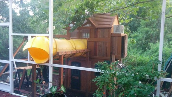 this tree house is amazing it is like a little oasis that every kid would love so it begins with having a slide that the child can climb from the house to