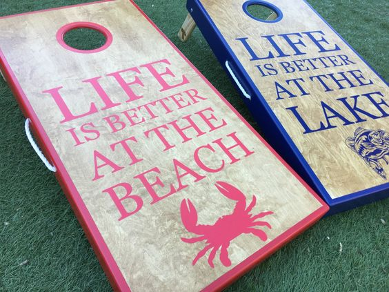 i like this cornhole board dcor idea because frankly i agree with the motto in my opinion life at the beach is pretty awesome - Cornhole Design Ideas