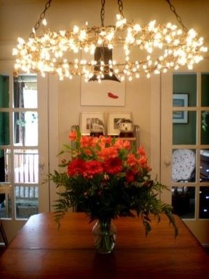 34 beautiful diy chandelier ideas that will light up your home this chandelier is created by using a hoop and then lighting it with battery operated christmas lights you then need a hanging mechanism aloadofball Images