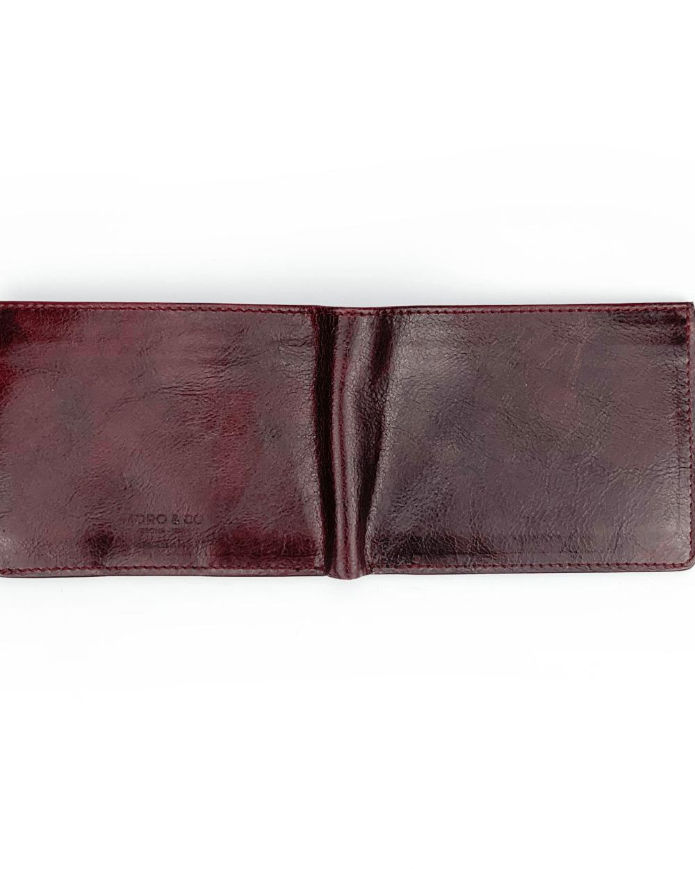 Portafoglio in vitello concia vegetale classico color vinaccia con pratiche tasche banconote, documenti, tessere e porta monete con automatico.