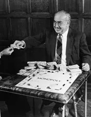 Charles Darrow playing his Monopoly game