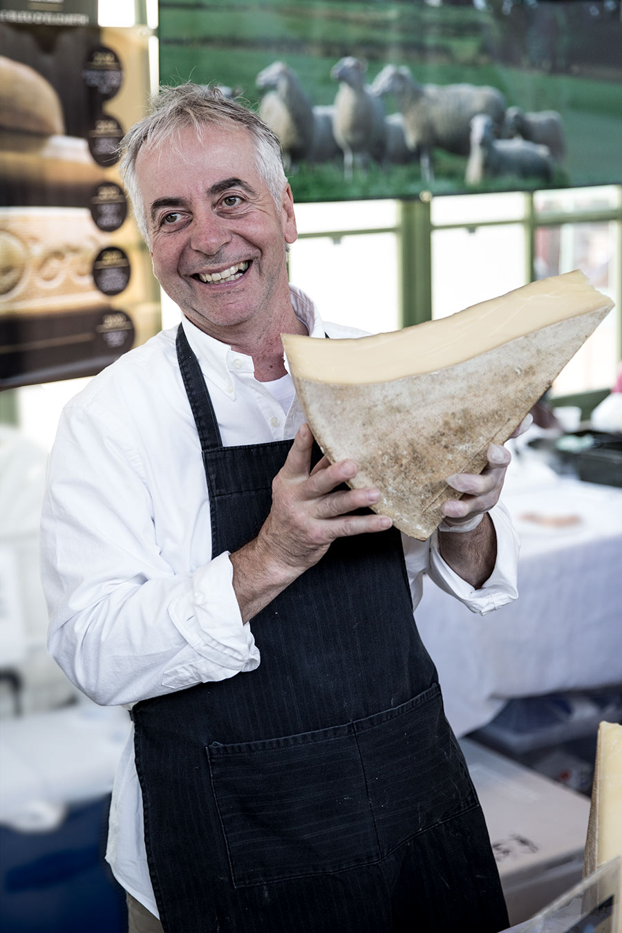 Cheesemaker Jean Morin holding a piece of his award-winning Louis d'Or.