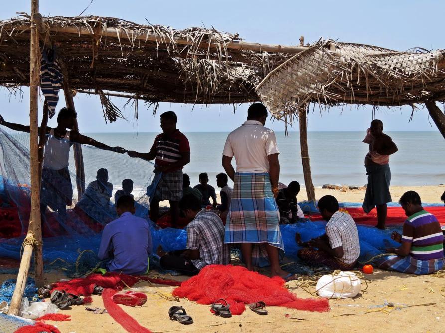 Fischer reparieren ihre Netze