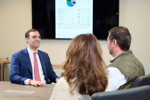 lifestyle photography of a financial services meeting in a corporate boardroom