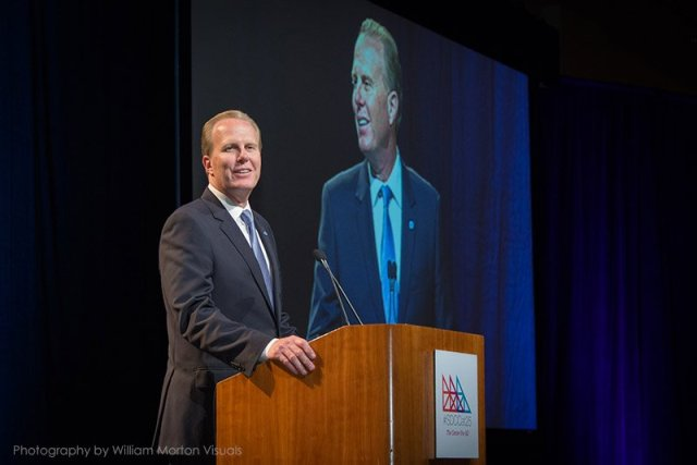 Mayor Kevin Faulconer speaks at the podium for the 25th anniversary of the San Diego Convention Center.