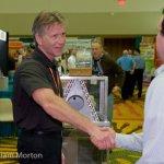 A vendor at the Johnstone Supply tradeshow greets a potential customer