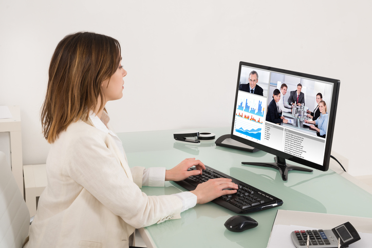 Young Businesswoman Video Conferencing On Computer In Office