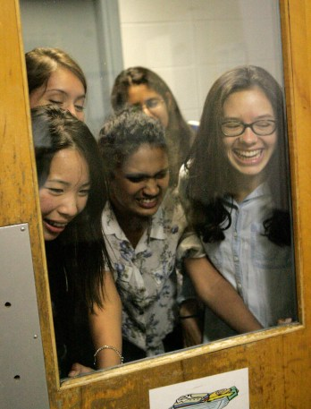 From left to right, Brenda Su, Sindhu Ravuri, and Hannah Knowles watch the cockroach slaying at Washburn Hall at San Jose State University in San Jose, Calif. on Tuesday, June 18, 2013. (Kelly Chang/Mosaic Staff)