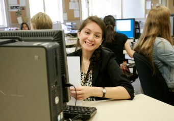Mahima Dutt // Mosaic Staff Photographer Adriana Ramos works on assignments in the newsroom.