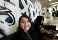 Mahima Dutt // Mosaic Staff Photographer Adriana Ramos smiles at the camera in the Washburn lounge.