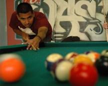 Matthew Chow // Mosaic Staff Writer Chris Moreno plays pool in Washburn Hall.