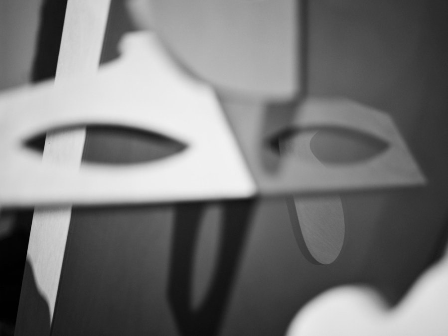 Black-and-white photograph of wooden abstract puzzle, the pieces representing the adaptability of language, by Gemma Tickle and Michael Bodiam