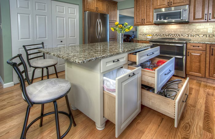kitchen islan cabinets on a budget st louis custom islands that also happens to be the storage workhorse of now you see it don t deep drawers hold up 50 pounds cooking equipment