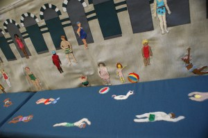 Embroidered picture of MRB swimmers
