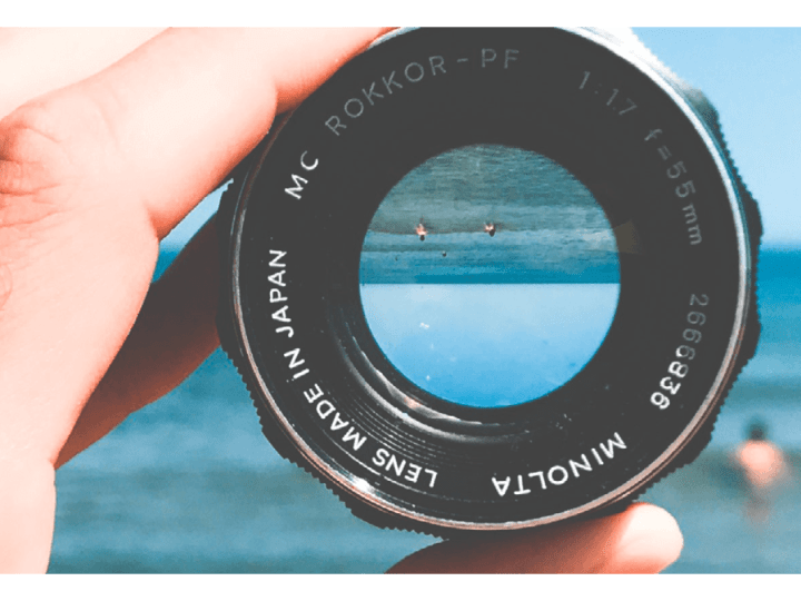 a hand holding lens towards the horizon
