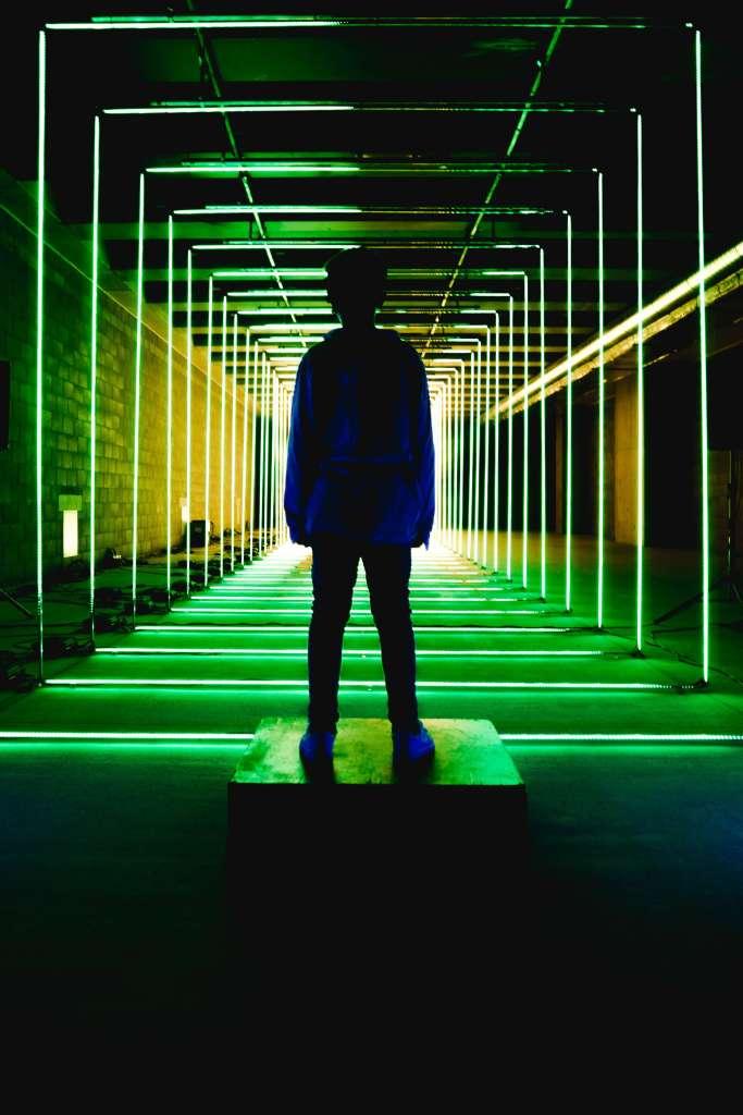 silluette of boy towards a green perpective symmetry principle