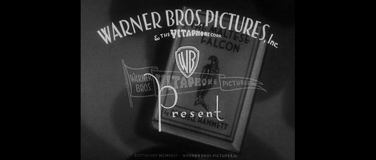 3027046-slide-2warner-bros-logo-1931-maltese-falcon