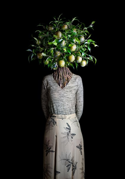 Roots by Miguel Vallinas showcases models with huge bouquets of flowers for heads.