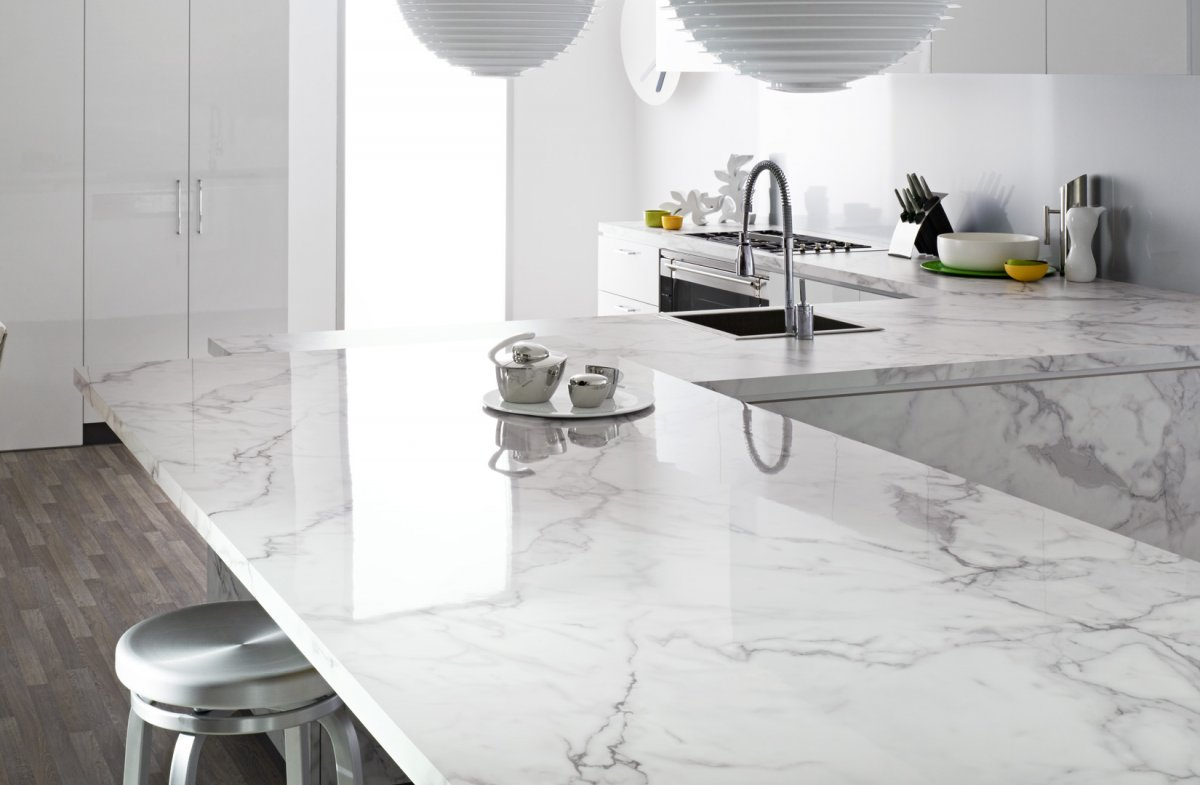 modern-kitchen-carrara-marble-kitchen-countertops-white-color-stainless-steel-pull-down-single-handle-spray-faucet-round-stainless-steel-bar-stools-grey-hardwood-flooring