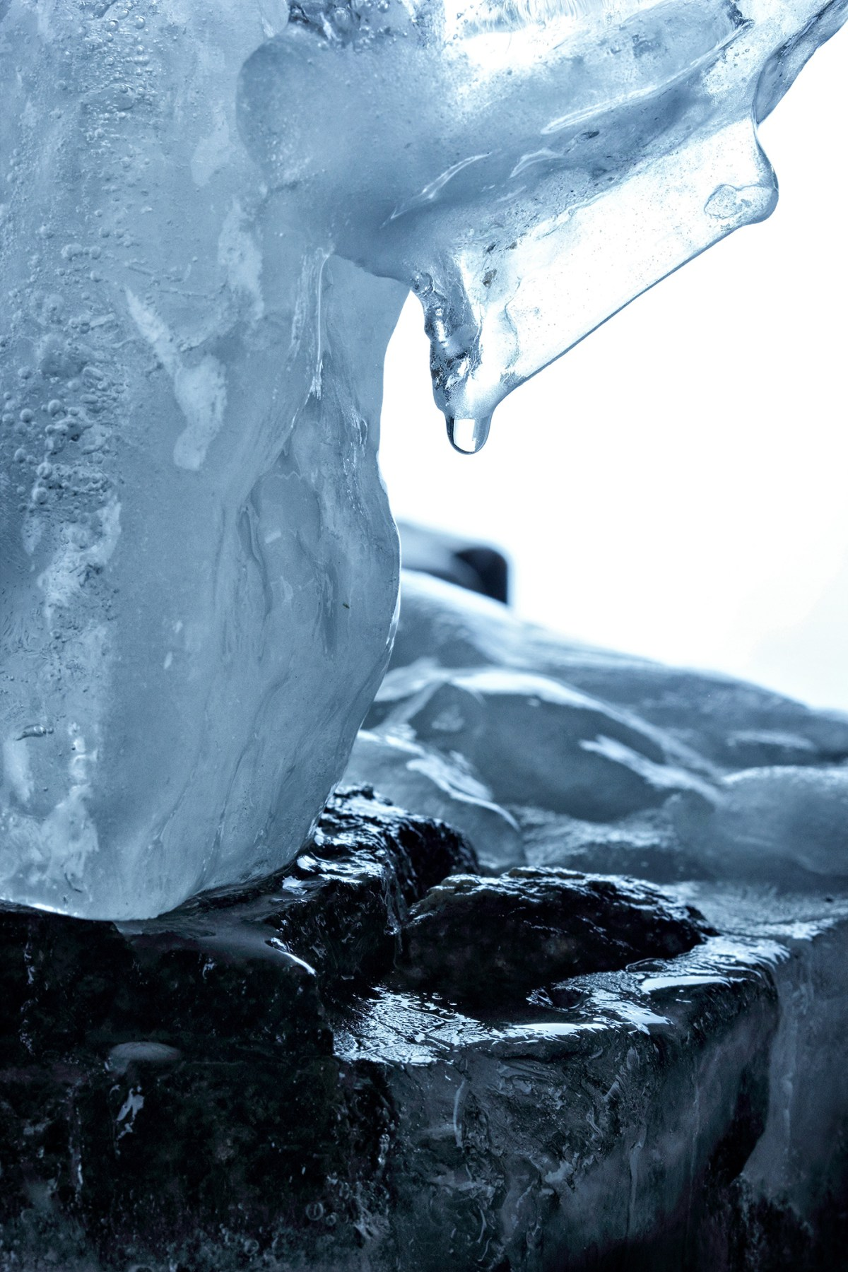 Melted ice abstract figureon the stone melted water drop .NAture background.