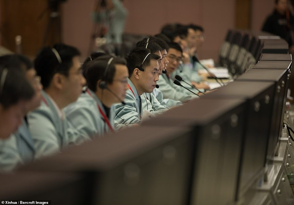 8079946-6551733-Technicians_work_at_the_Beijing_Aerospace_Control_Center_BACC_in-a-1_1546527035167