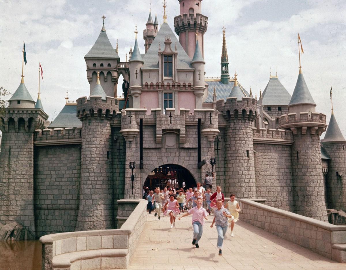 Children running through gate of Sleeping Beauty's