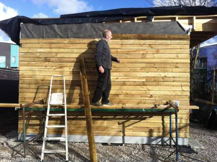 Late February, here's Phil finishing up the cladding for the community hub